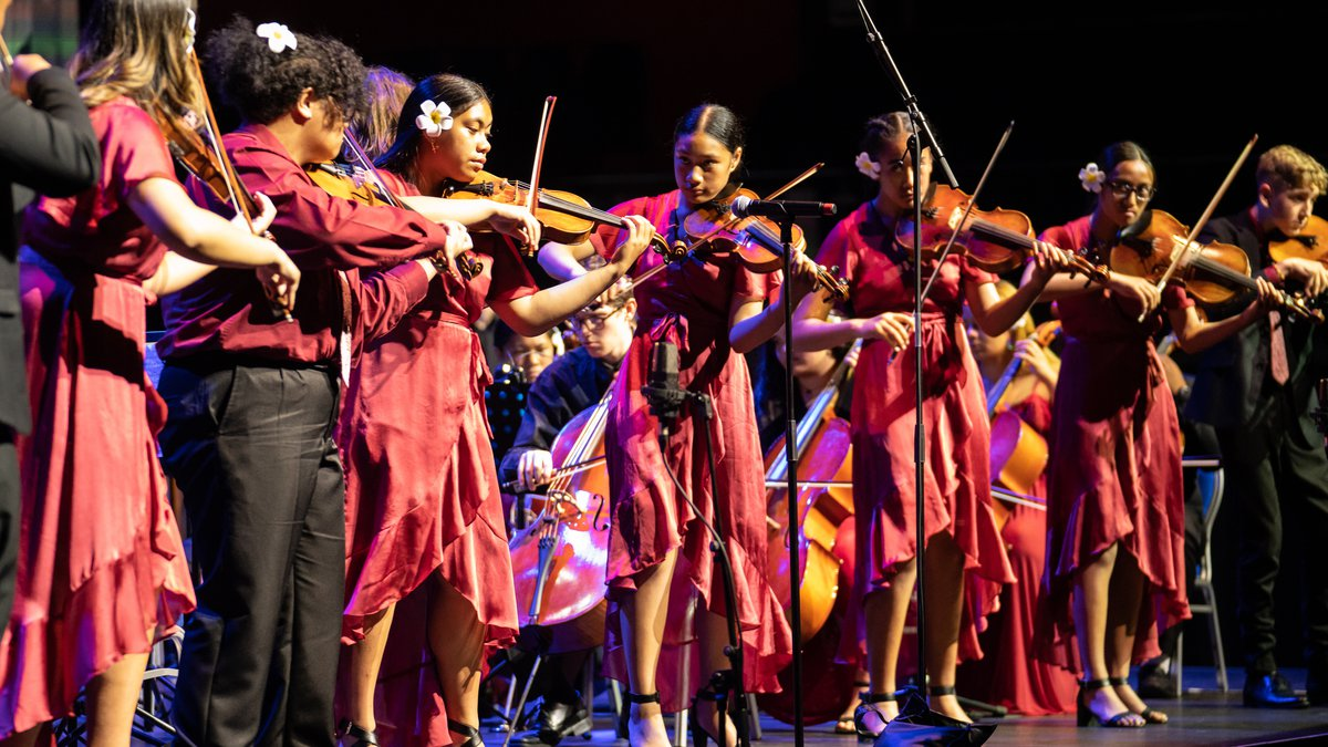 Te Ata Festival: Sinfona for Hope image with children playing violin. New Zealand Festival of the Arts 2020